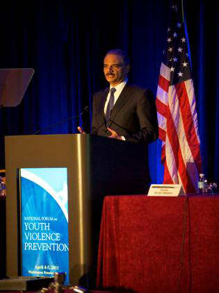 U.S. Attorney General Eric Holder speaking at the Summit on Preventing Youth Violence in April 2011