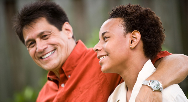 Adult mentoring a youth