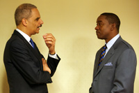 The Honorable Eric H. Holder, Jr., Attorney General of the United States, with Isaiah Thomas