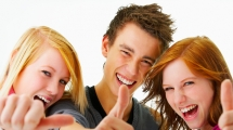 Group of youth giving a thumbs up